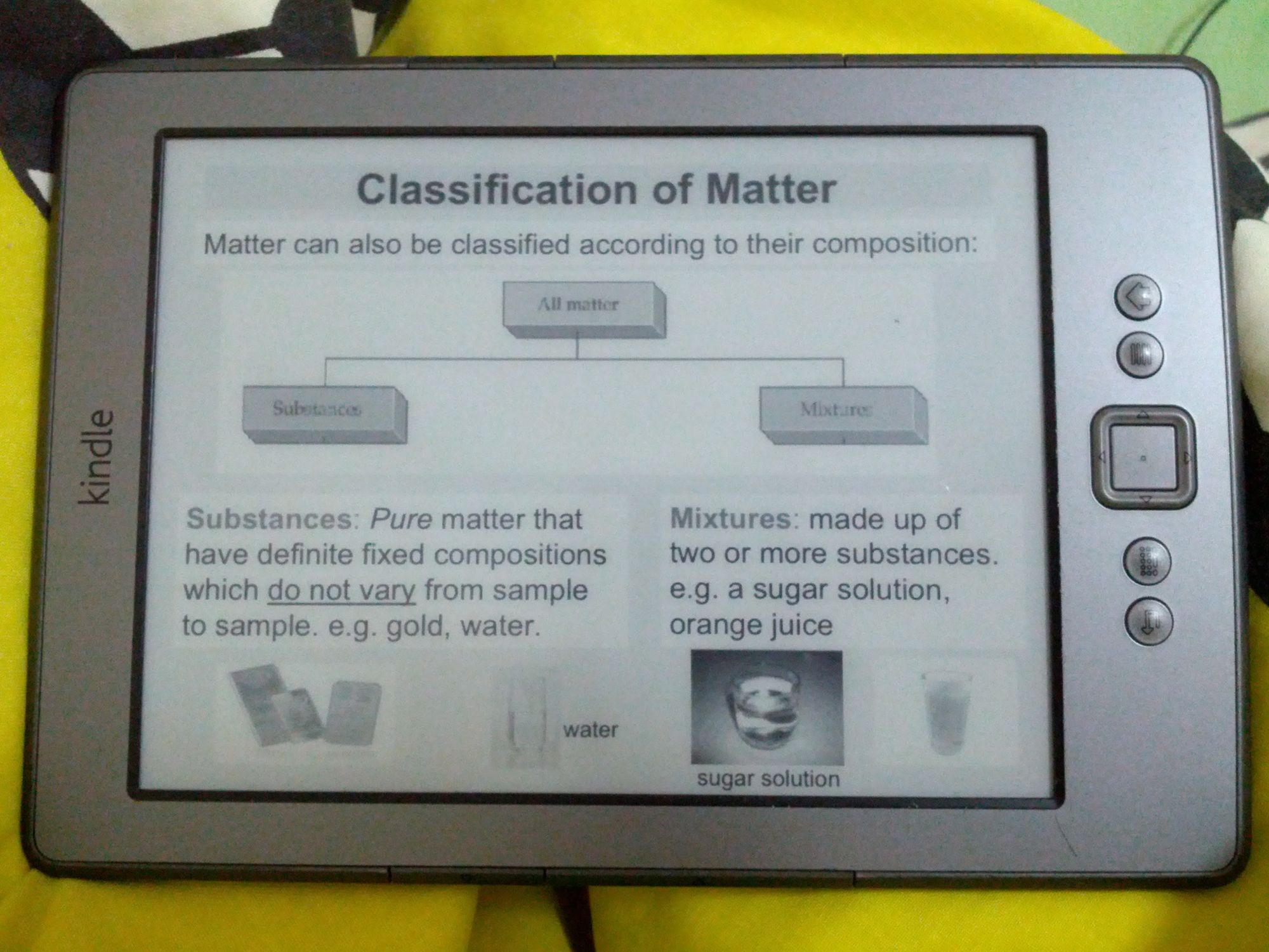 """A Kindle (2021) horizontally, showing slides of """"Classification of Matter"""""""