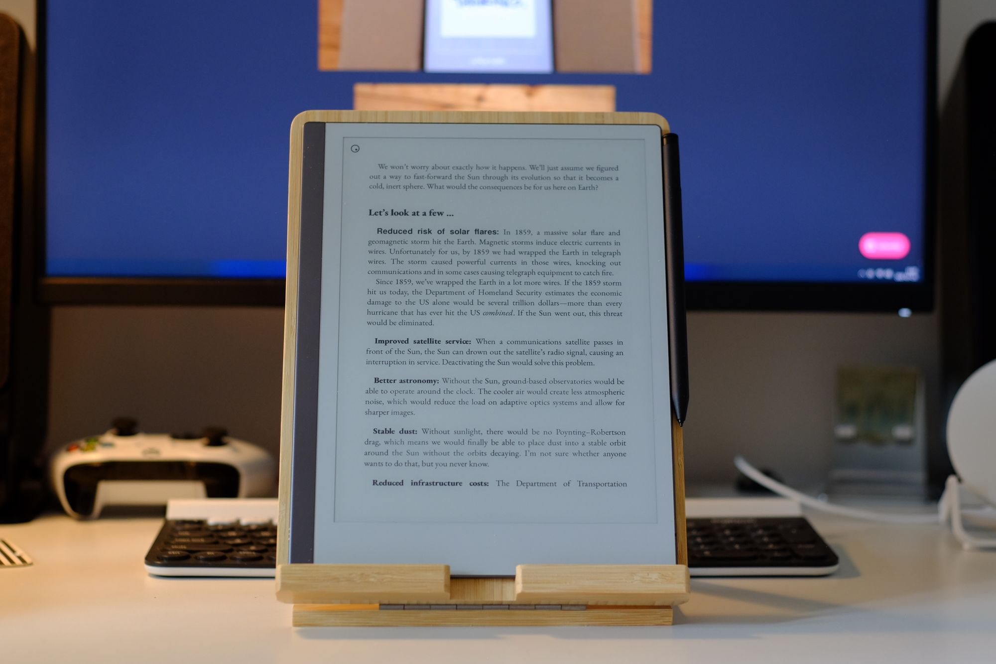 Picture on reMarkable 2 showing a book on the screen, on a bamboo tablet stand.